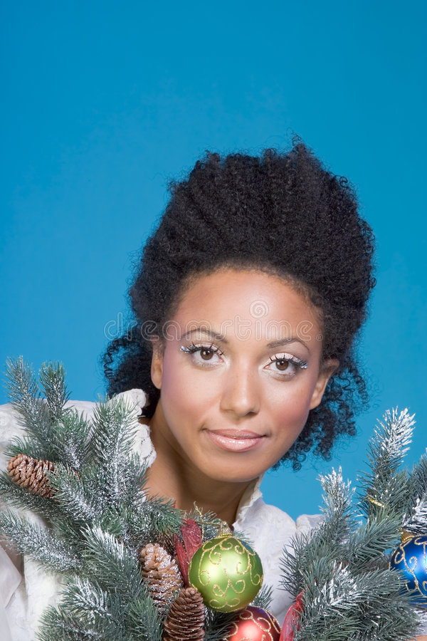 Decorated Christmas portrait of ethnic woman royalty free stock photo
