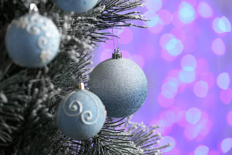 Decorated Christmas tree against blurred lights on background. Bokeh effect royalty free stock photo