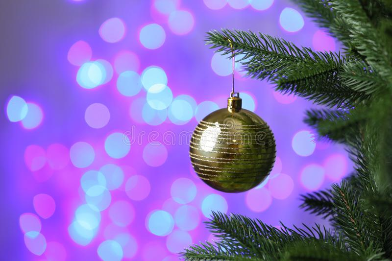 Decorated Christmas tree against blurred lights. On background. Bokeh effect royalty free stock images