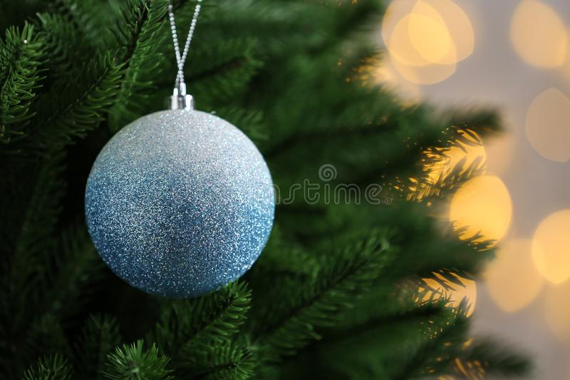 Decorated Christmas tree against lights on background. Bokeh effect. Decorated Christmas tree against blurred lights on background. Bokeh effect stock images