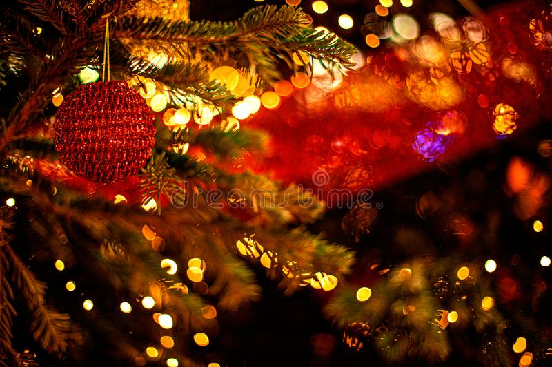 Decorated Christmas tree on blurred background with abstract  golden bokeh lights. Beautiful Merry Christmas and Happy New Year royalty free stock images