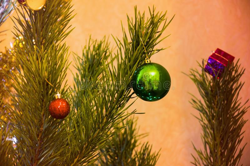 Decorated Christmas Tree closeup. Colofrul balls and garland shining royalty free stock photos