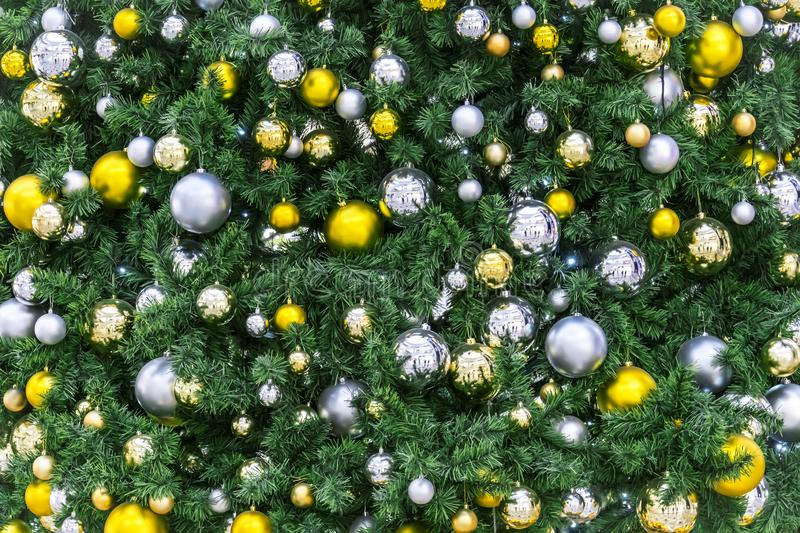 Decorated Christmas tree closeup. golden balls. New Year baubles macro photo with bokeh. Winter holiday light decoration. Decorated Christmas tree closeup royalty free stock photography