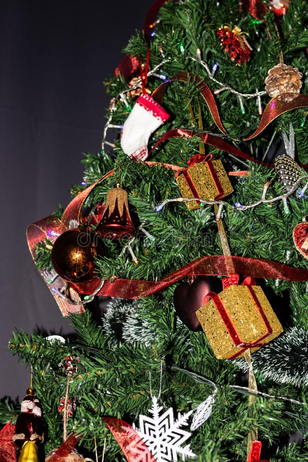 Decorated Christmas tree,  Fir braches  with hanging decorations and garlands. Christmas concept.  stock images
