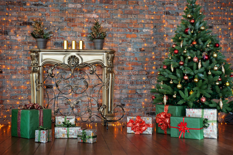 Decorated Christmas tree and gift boxes in living room royalty free stock photo