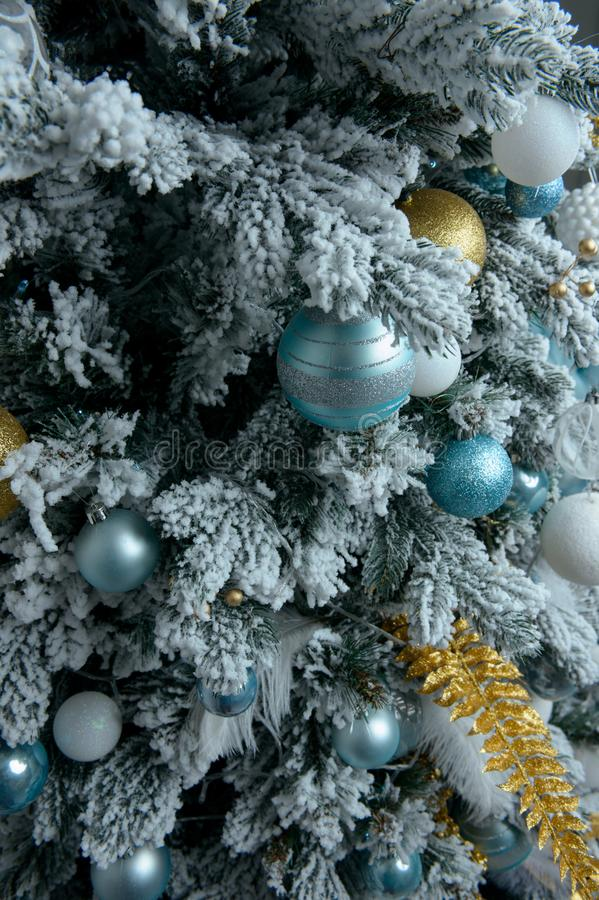 Decorated Christmas tree with gifts close up on white background royalty free stock photo