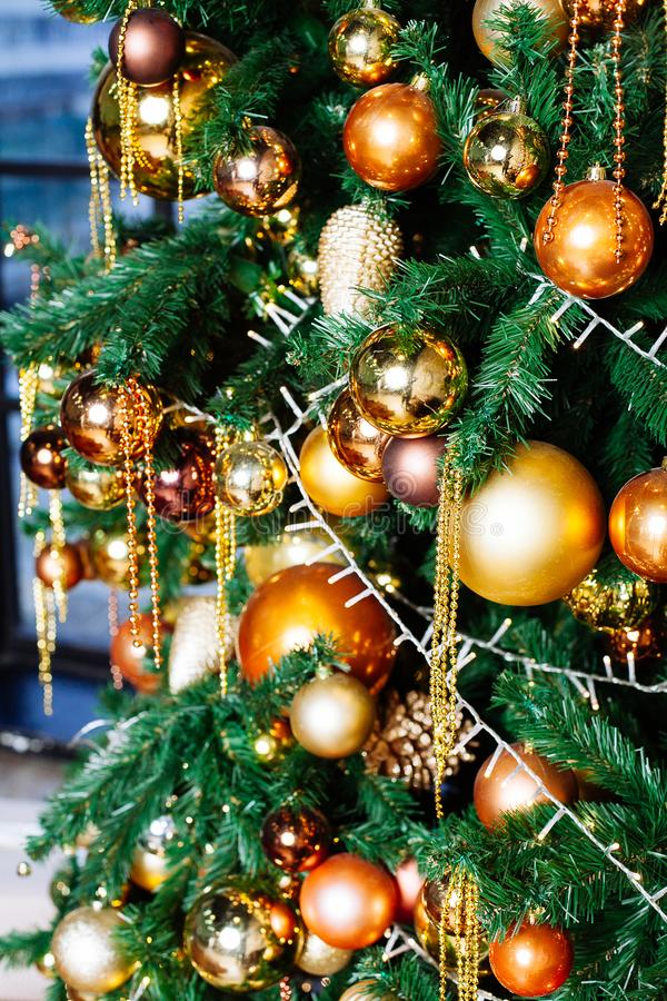 Decorated Christmas tree in gold and yellow colors. Merry Christmas and  New Year. Decorated Christmas tree in gold and yellow colors. Merry Christmas and Happy stock photo