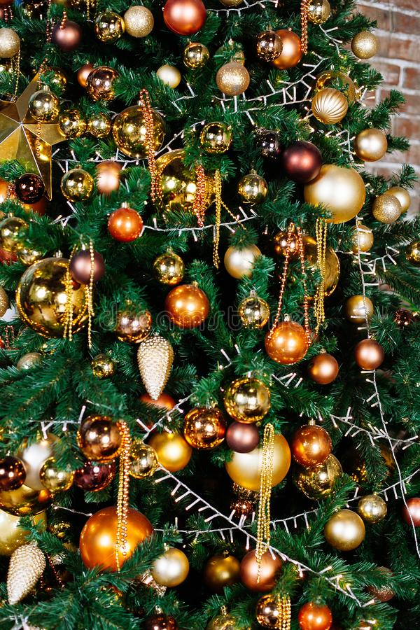 Decorated Christmas tree in gold and yellow colors. Merry Christmas and Happy New Year. Decorated Christmas tree in gold and yellow colors. Merry Christmas and stock photography