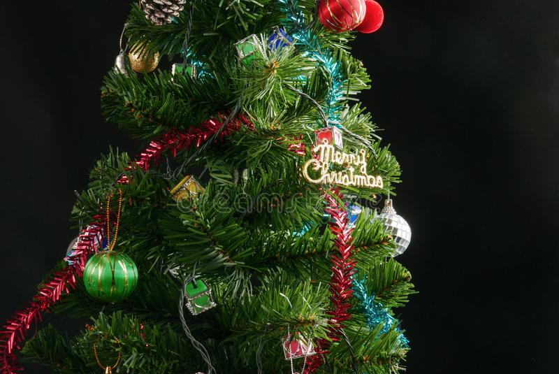 Decorated Christmas tree isolated on black background studio shot for family, giving, season, Christmas, holiday, new year. Travel, Christian and gathering stock images