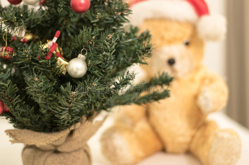 Detail on decorated Christmas Tree with Teddy Bear in the background. Close up photography of detail of a Christmas Tree decorated with red and white Christmas royalty free stock image