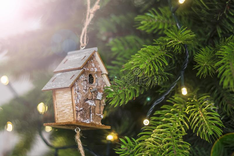 Decorated Christmas tree with vintage birdhouse decoration. Selective focus. Christmas, New Year`s concept. Close-up. royalty free stock photo