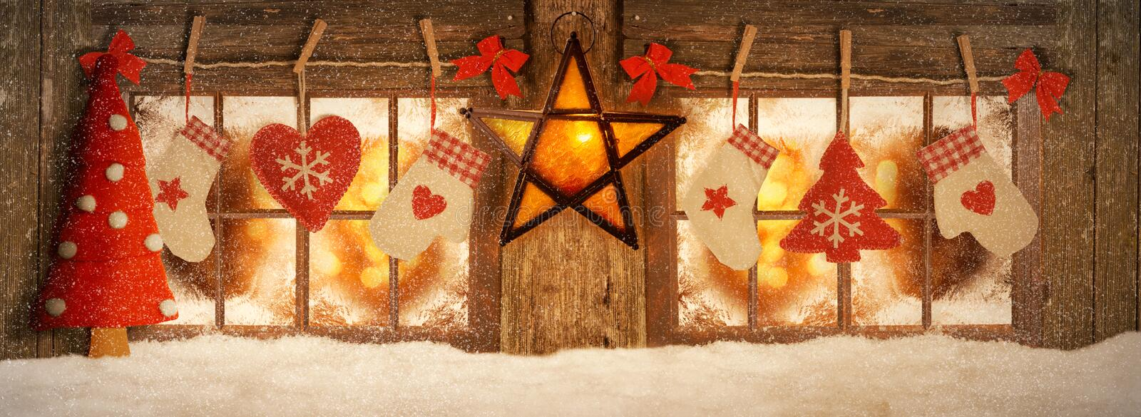 Decorated for Christmas windows. Mood lighting royalty free stock photos