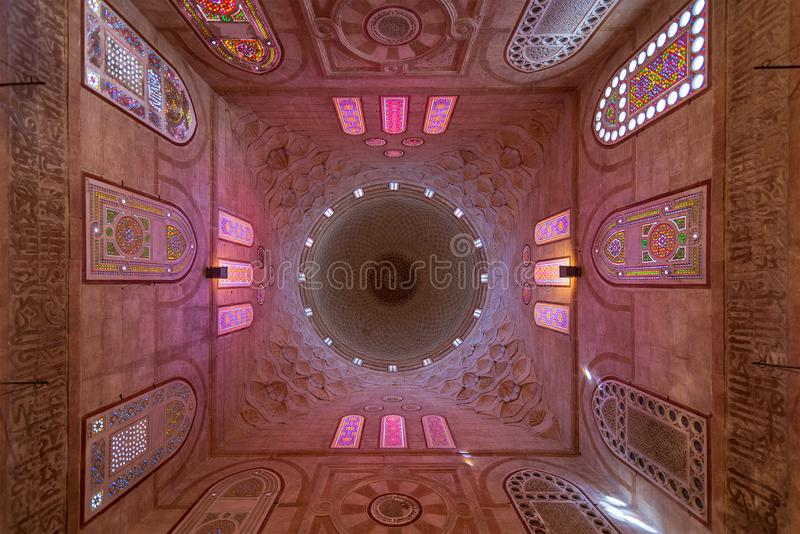Decorated dome mediating ornate ceiling with floral pattern decorations at Khayer Bek Mausoleum, Cairo, Egypt stock photos