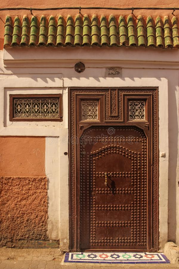 Decorated door. Marrakesh . Morocco. A typical decorated entrance in the medina. Marrakesh . Morocco royalty free stock photos