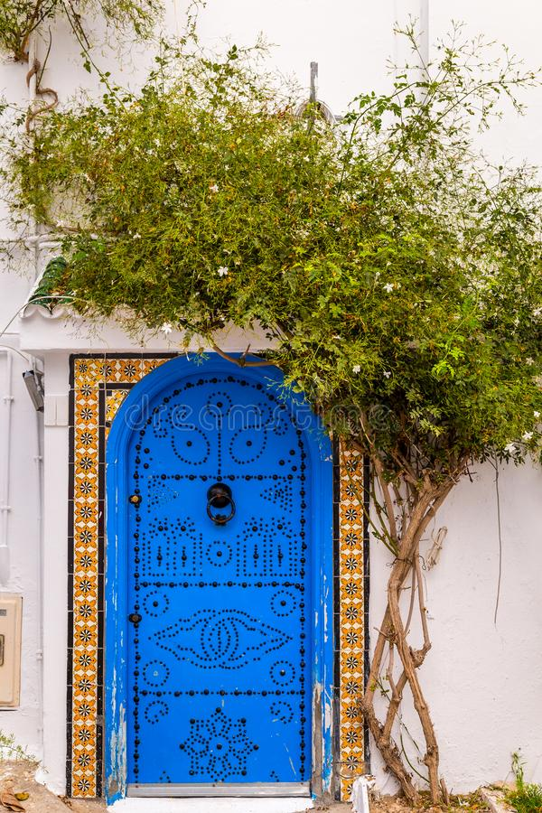Decorated door in Tunisia. Decorated door of a traditional house in Tunisia stock images
