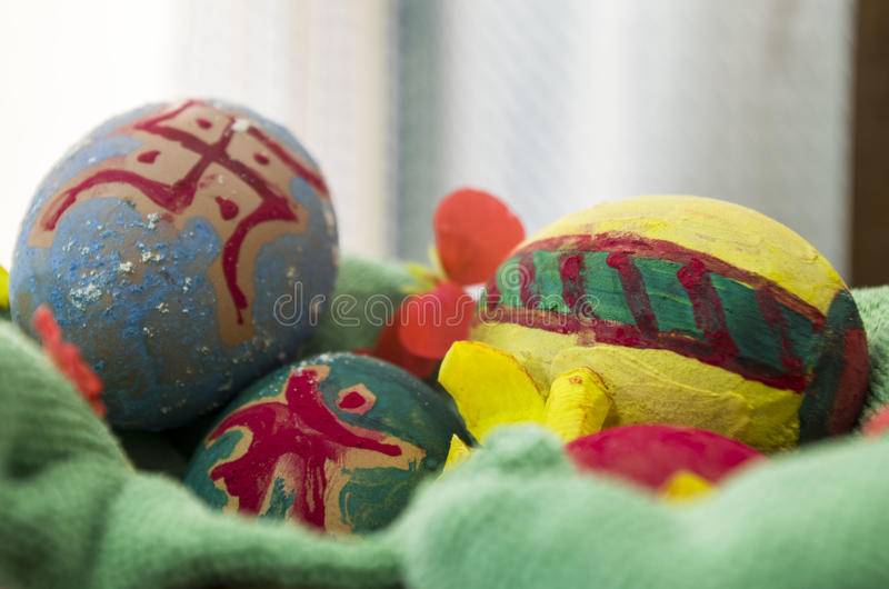 Decorated Easter Eggs. In a basket with cloth and flowers royalty free stock photos