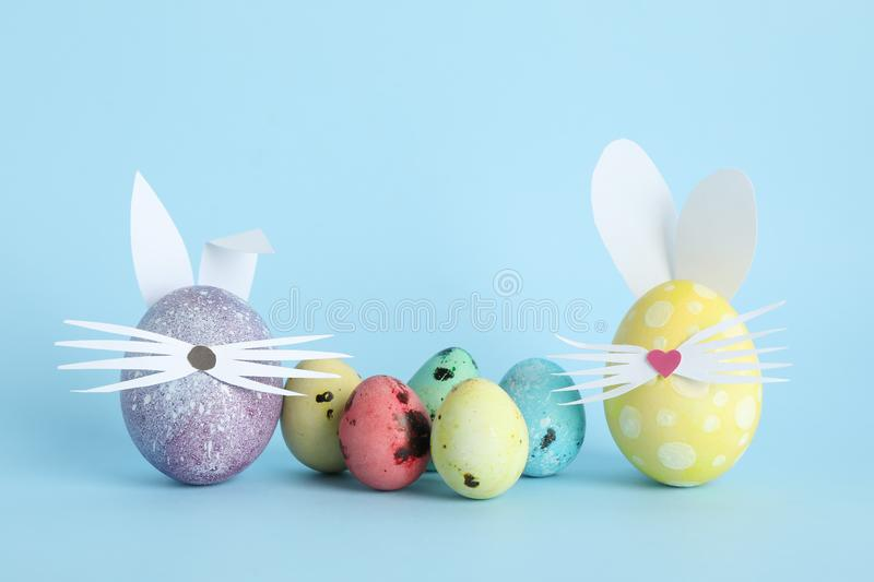 Decorated Easter eggs and cute bunny`s ears stock images