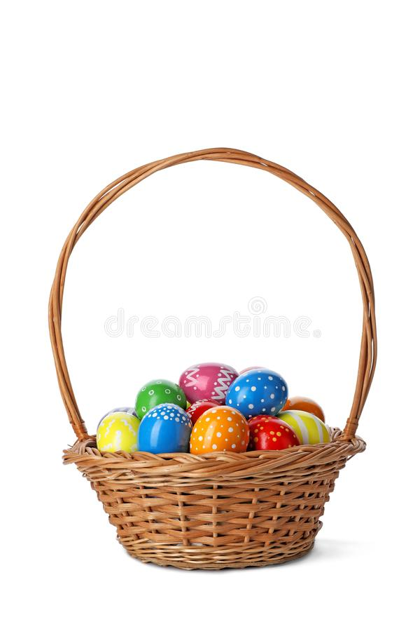 Free Decorated Easter Eggs In Wicker Basket On White Stock Photo - 136040720