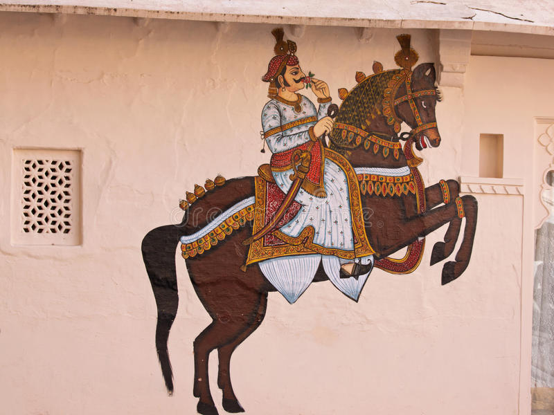 Decorated external wall in Udaipur, India. UDAIPUR, INDIA – MARCH 5, 2015: Detail from wall art adjacent to the City Palace in Udaipur, India, which dates stock images