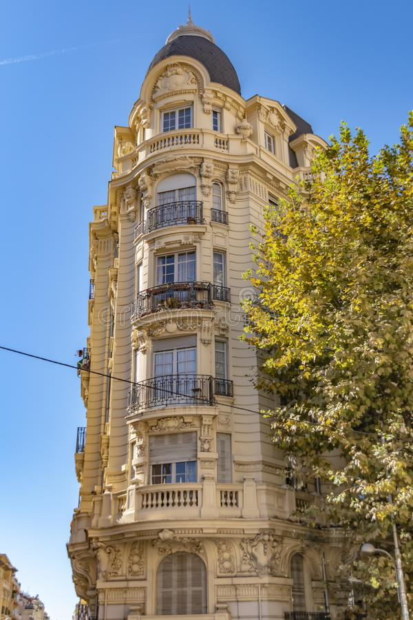 Decorated facade of a historic house in Nice, France. You can see the typical windows, balconies and shutters of a Mediterranean c. View to the decorated facade royalty free stock photography