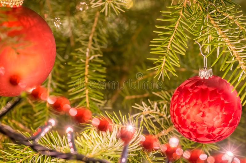 Decorated with fairy lights, Christmas balls and string of pearls Christmas tree in detail royalty free stock photo