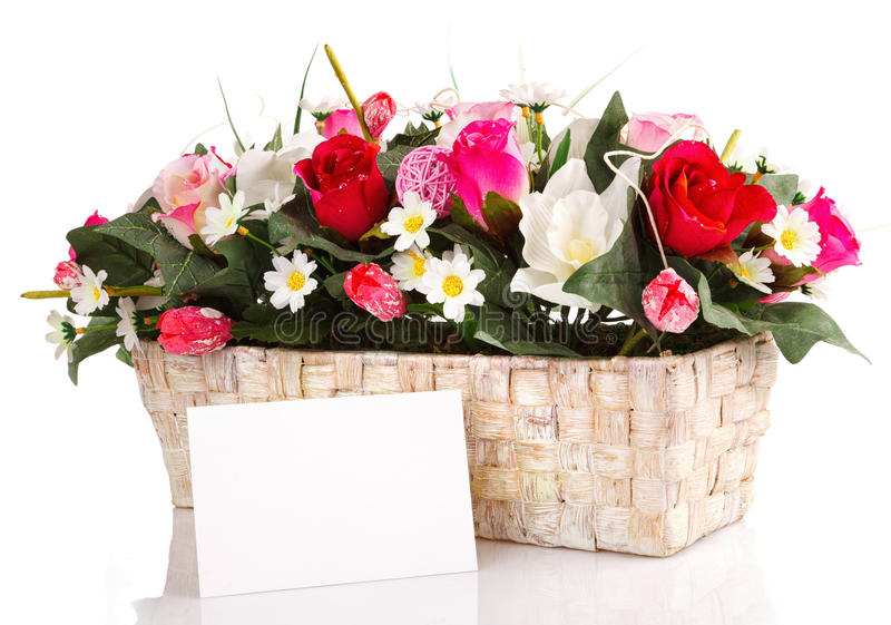 Decorated flowers basket. Vith with blank card isolated stock image