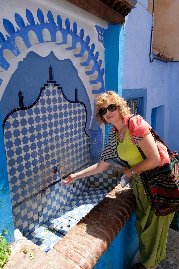 Decorated fountain with mosaic tiles in Chefchaouen stock images