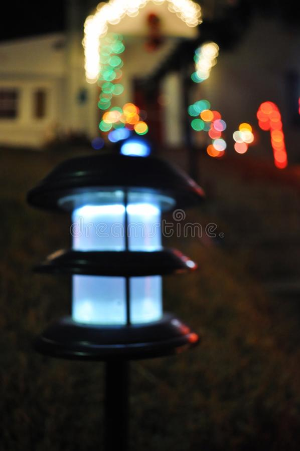 Decorated a front house with color lights, red, green, and white. Decorated a front house with color lights, red, green, and white to welcome a goodness in a stock photo