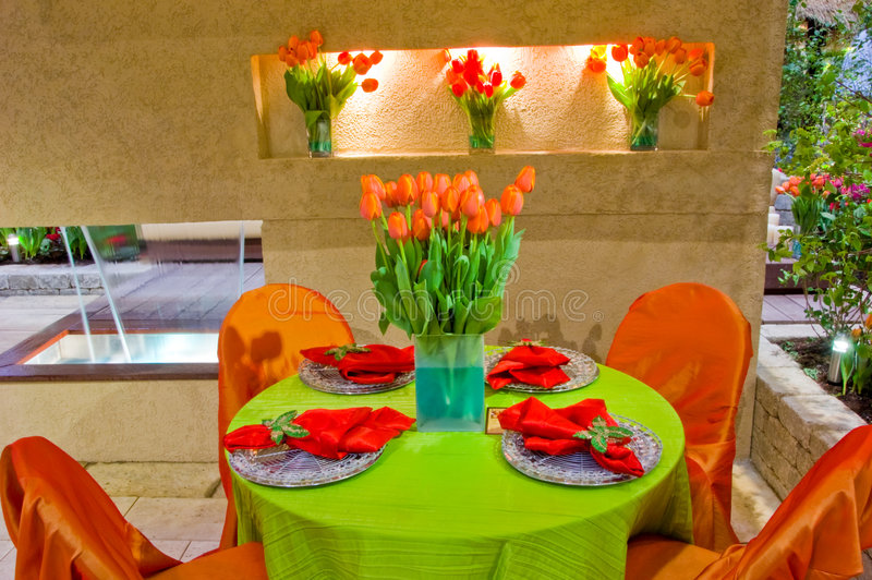 Decorated Garden Patio. A decorated table and chairs located in the garden patio ready for guests stock image