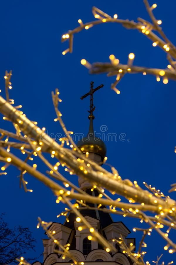 Decorated with garlands of tree branches against the cross on th stock photos