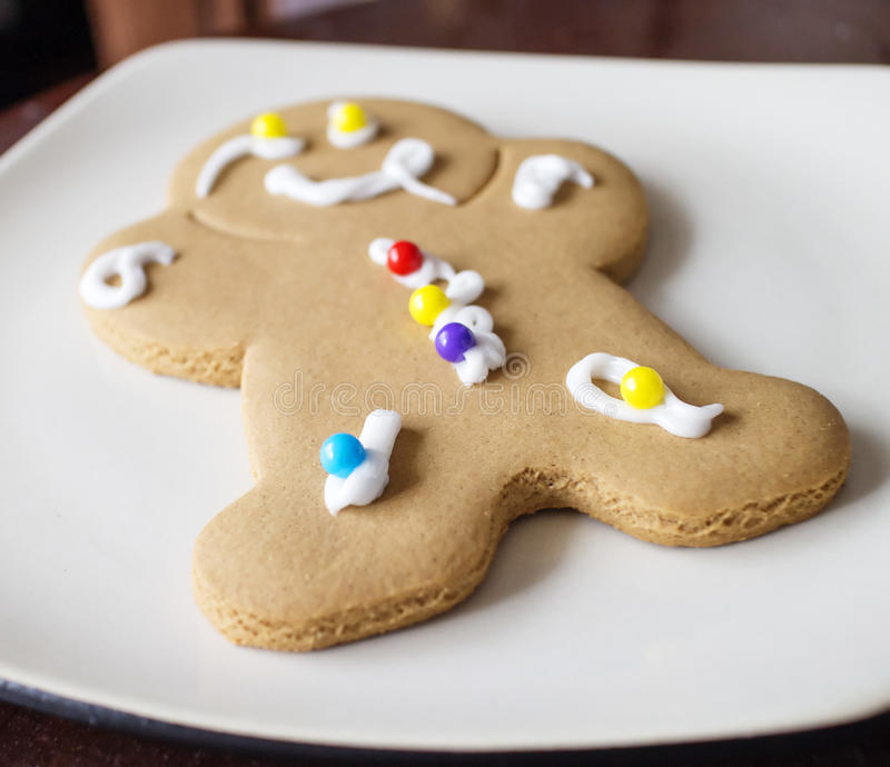 Download Decorated Gingerbread Man On White Plate Stock Photo - Image: 28720716