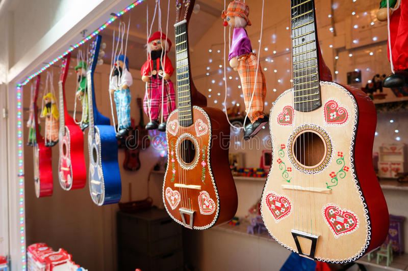 Decorated guitars hanging in line royalty free stock photo