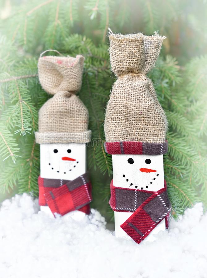 Decorated handmade wooden snowmen royalty free stock photography