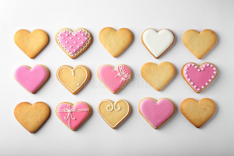 Decorated heart shaped cookies on white background stock photography