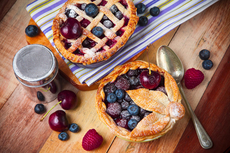 Decorated homemade shortcrust pastry berry pies royalty free stock photos