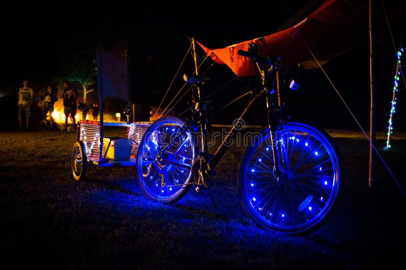Decorated LED lights bicycle at night with blue lights. Decorated LED lights bicycle at night blue lights royalty free stock photography