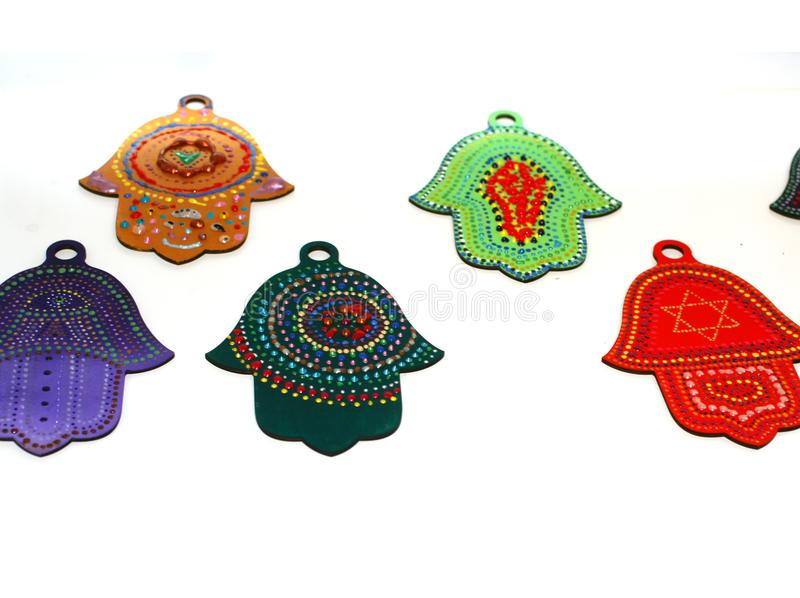 Decorated multi-colored hand hamsa. Beautiful Spot Painting. royalty free stock photos