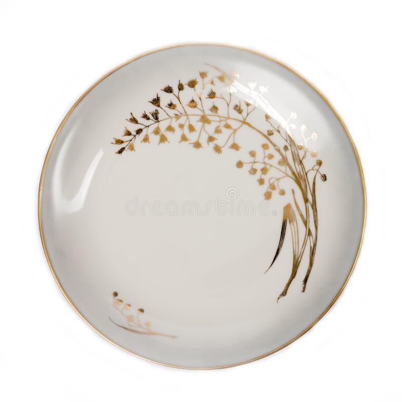 Decorated porcelain dish isolated on white background - photo. One Decorated porcelain dish, isolated on white background - photo royalty free stock photography