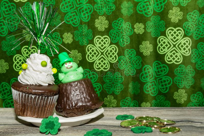 Cute decorated Saint Patrick`s day cupcakes. royalty free stock photography