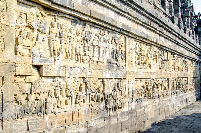 Decorated stone with bas reliefs in the Borobudur temple in Yogyakarta, Java, Indonesia. royalty free stock photography
