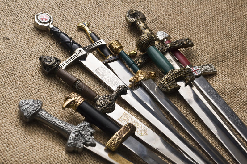 Decorated swords. Various swords with different handles royalty free stock photo