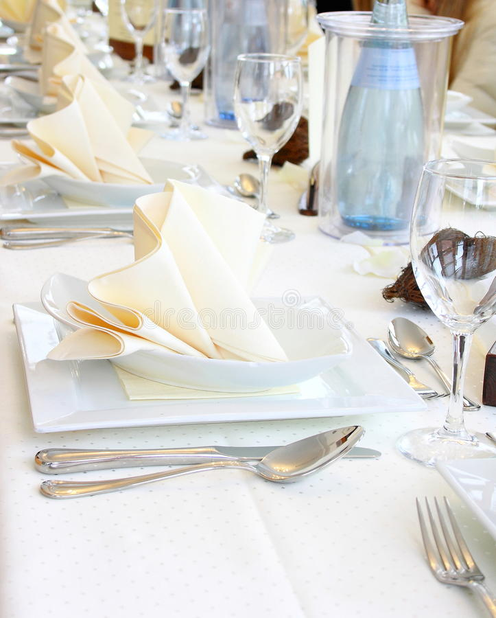 Decorated table in restaurant waiting for party. Vertical royalty free stock images