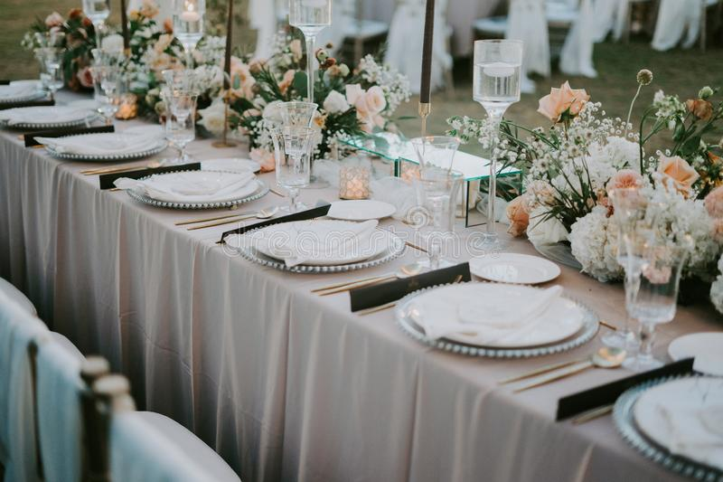 Decorated table setting with a floral design for a wedding celebration during daytime stock photography