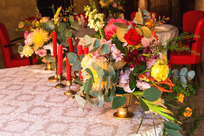 Decorated table, vases of flowers. Close up. Wedding concept stock photography