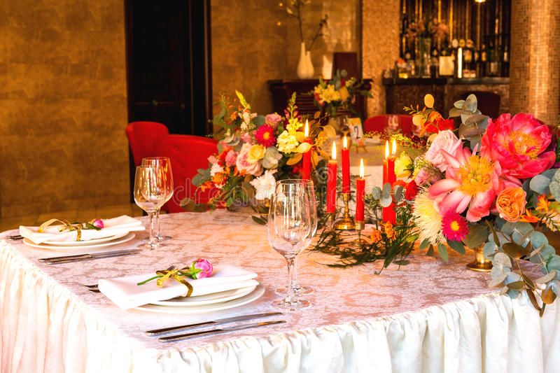 Decorated table, vases of flowers. Close up. Wedding concept stock images