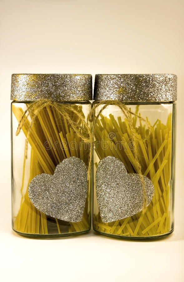 decorated two jars of spaghetti royalty free stock images