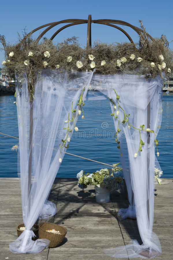 Wedding pavilion. Beautiful decorated wedding pavilion at the seaside to welcome the wedding couple royalty free stock photography