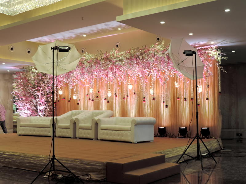 Decorated wedding reception stage at traditional Hindu wedding, India. Decorated wedding reception stage with flowers for a Hindu wedding in India. Lights stock photo
