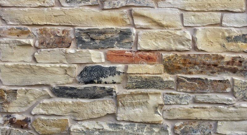 decoratieve rustieke die steen in bouw wordt gebruikt stock fotografie