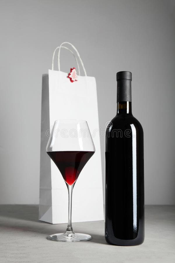Decorating a bottle of red wine for Christmas royalty free stock photos